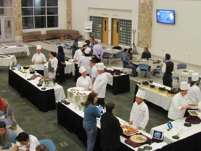 Culinary students prepare foods for industry professionals.