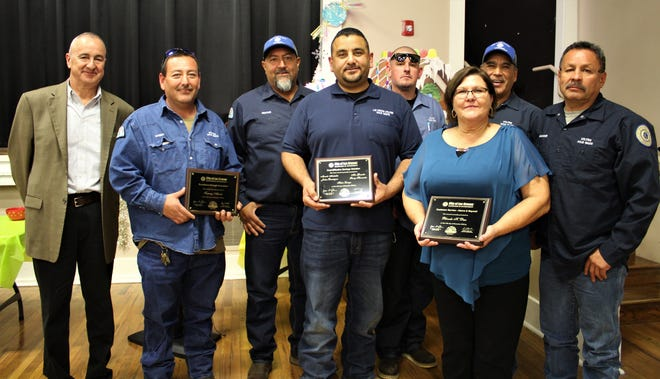 Las Cruces Utilities Director Jorge Garcia, from left, with LCU Employee Award winners Sammy Atencio, Hector Lozoya, Marcelo Archuleta, Joshua Dominguez, Rhonda Diaz, Max Gonzalez and Sonny Hernandez.