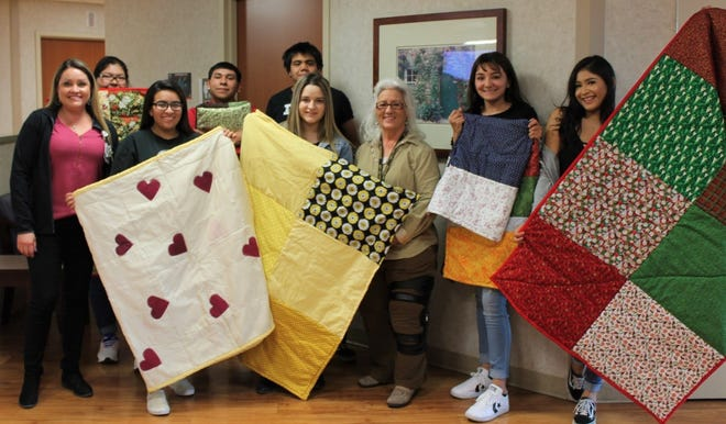 From left to right, Samantha Gomez, director of women's services at MountainView Regional Medical Center, RGPI students Desanae Gonzalez, Ammerece Michel, Milagro Ortega, Julio Garcia, Vanessa Esparza, teacher Francis Melendrez, and students Briana Mirabal and Ashley Zuniga-Arzabal.