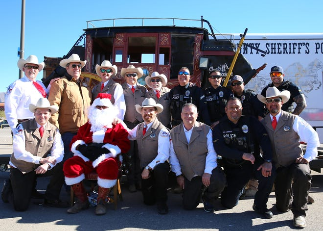 The El Paso Sheriff's Posse and Sunland Park Police Department delivered over 700 toys to children from Sunland Park and Santa Teresa Elementary Schools.