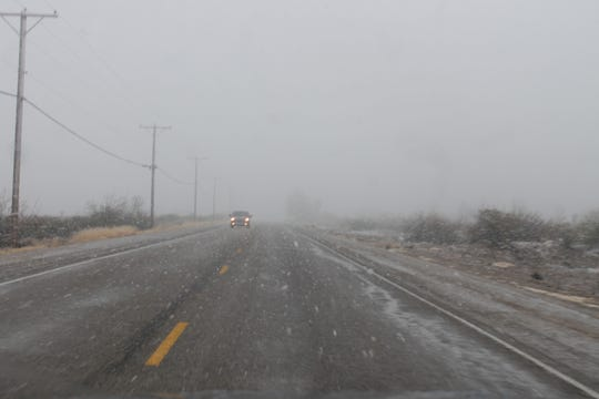 Driving conditions were precarious and visibility diminished on Friday afternoon due to the winter storm.