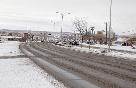 Snow made for wet and slushy conditions on East Main Street in Farmington on Friday.