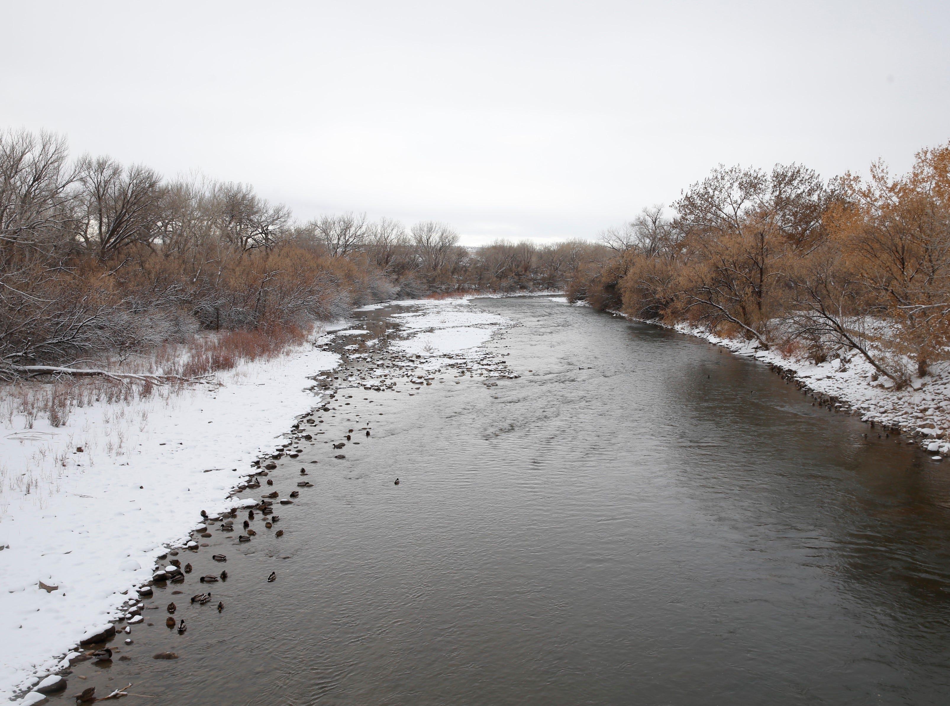 Snow surrounds the Animas River on Friday in Farmington.