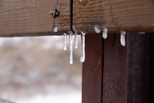 Icicles form along a rail on the Animas Bridge at Berg Park on Friday.