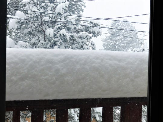 A back deck railing in Ruidoso showed significantly more than a foot of snow in early afternoon Friday.
