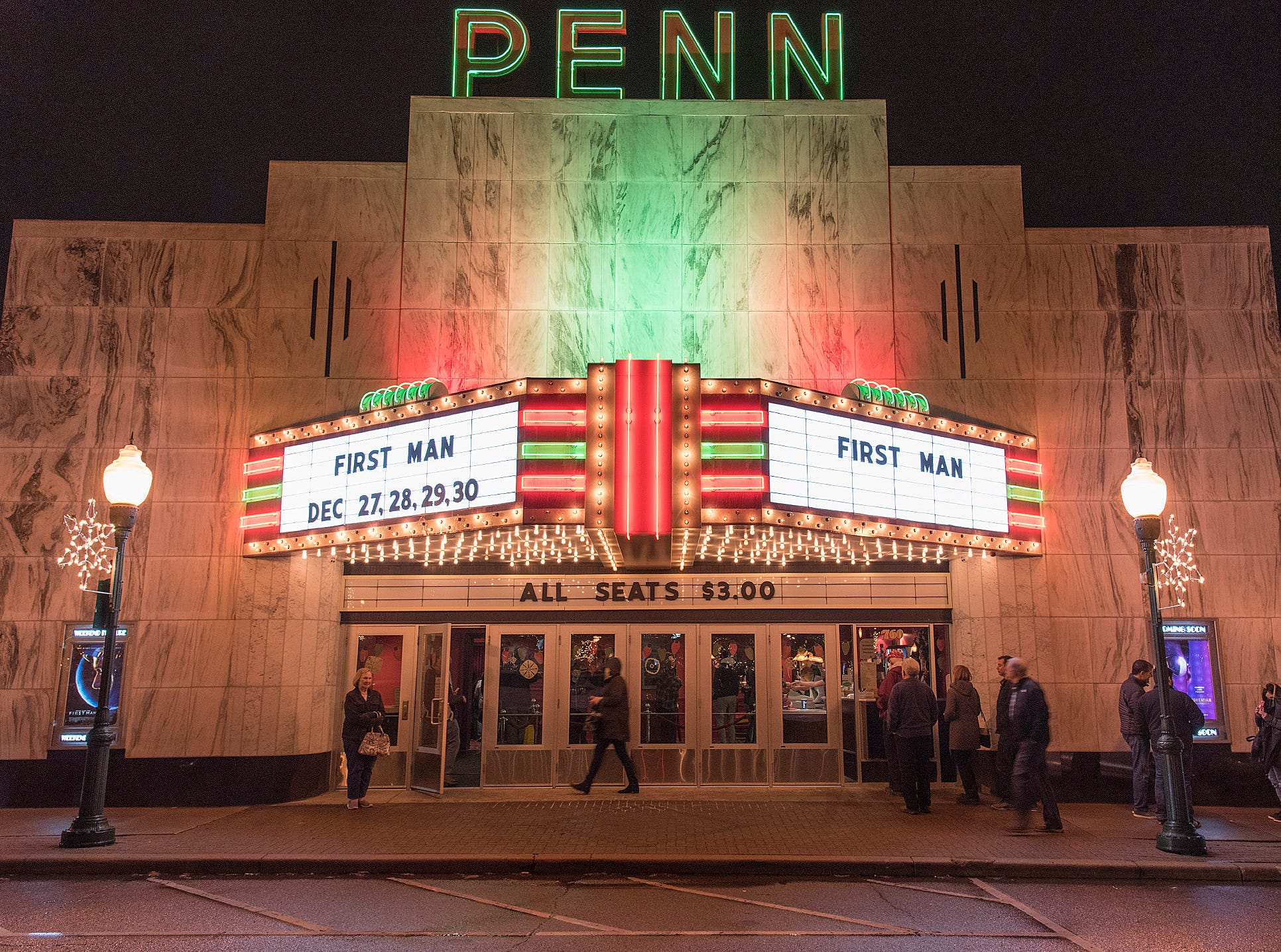 Plymouth's Penn Theater, draws patrons on a rainy Thursday night.