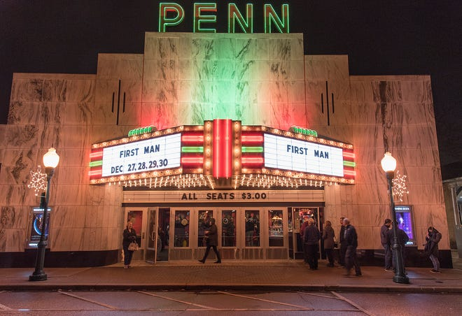 Plymouth's Penn Theater, draws patrons on a rainy Thursday night.