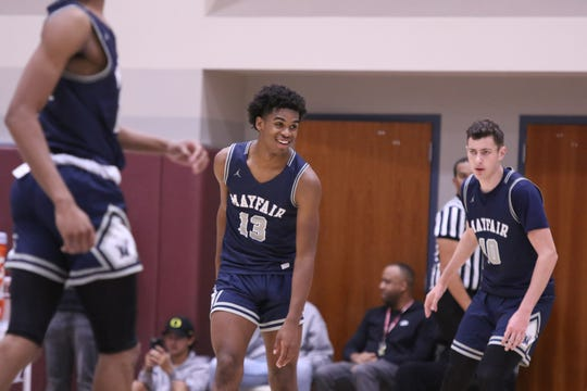 Mayfair's Josh Christopher, center, smiles during the game against the Knight's during the Rancho Mirage Holiday Classic in Rancho Mirage on Thursday, December 27, 2018.