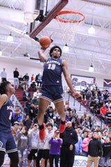 Mayfair's Josh Christopher during a dunk contest Dec. 27, 2018.