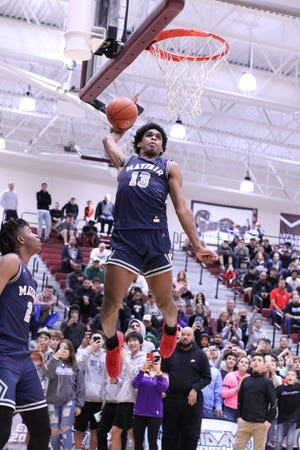 Mayfair's Josh Christopher dunks the ball during the dunk contest at Rancho Mirage Holiday Classic in Rancho Mirage on Thursday, December 27, 2018. Christopher won the contest.