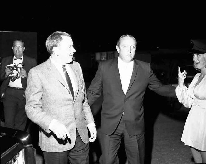 Frank Sinatra and Jilly Rizzo at the opening of Jilly's Palm Springs in October 1965.