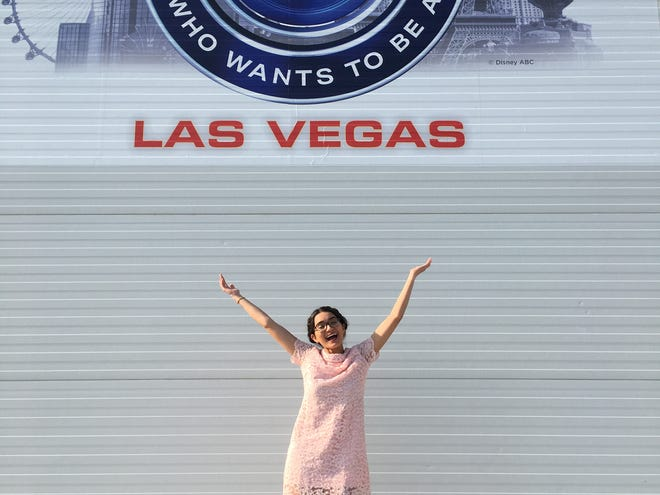 """UWF student Samantha Brown poses for a photo outside of the """"Who Wants to Be a Millionaire"""" studios in Las Vegas."""