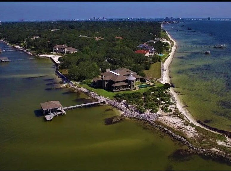 The most expensive house currently on the market in either Santa Rosa or Escambia County is this $12,000,000 waterfront abode on its own peninsula in Gulf Breeze. The six bedroom, 7.5 bathroom mansion boasts nearly 12,000 square feet and water views on three sides. It's listed by Todd Vannoy with Real Estate International, Inc. 850-830-7253.