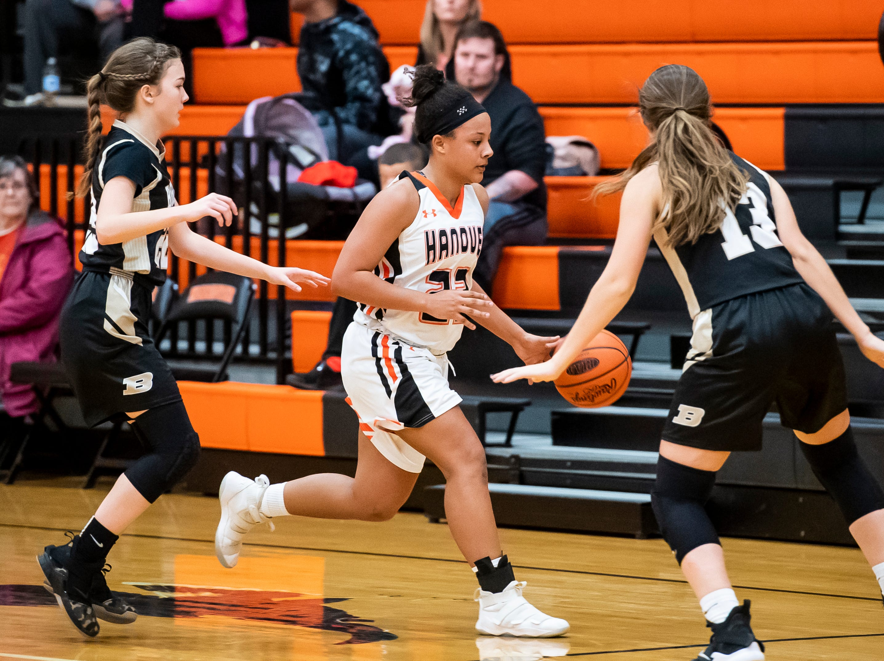 Hanover's Mattie Heath dribbles between a pair of Biglerville defenders in the championship game of the Hanover Holiday Classic on Friday, December 28, 2018. Hanover won 30-20.