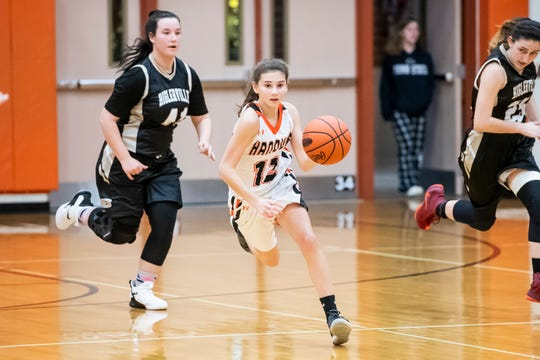 Hanover's Jaycie Miller dribbles down the court during play against Biglerville in the championship game of the Hanover Holiday Classic on Friday, December 28, 2018. Miller is a 5-foot-3 point guard for the Nighthawks, starting as a freshman.