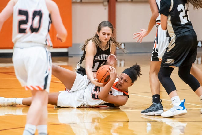 Hanover's Mattie Heath maintains possession of a loose ball during play against Biglerville in the championship game of the Hanover Holiday Classic on Friday, December 28, 2018. Hanover won 30-20.