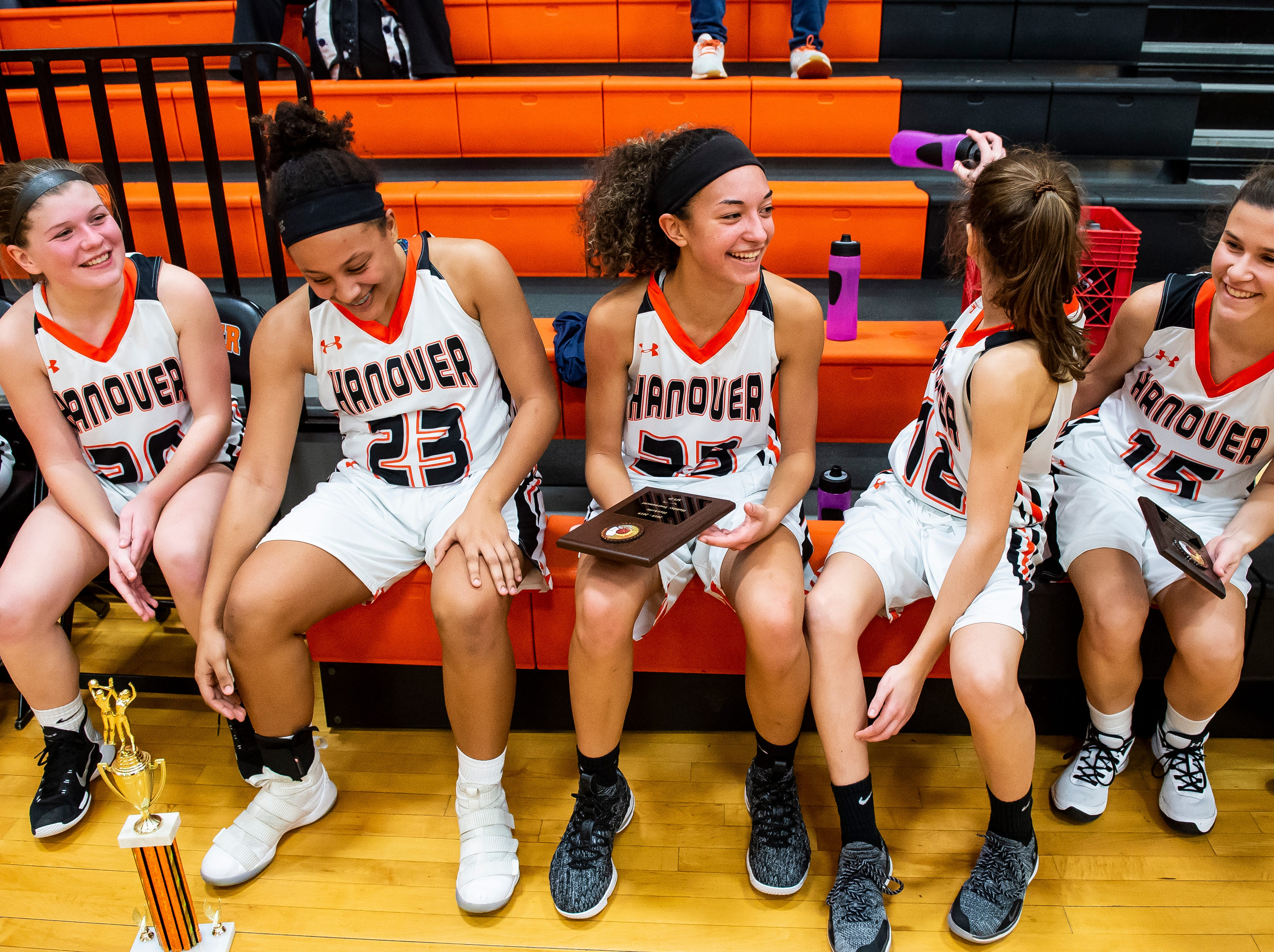 (From left) Hanover's five starters; Saige Stevens, Mattie Heath, Tianna Gray, Jaycie Miller and Madelyn Hutton following the Hawkettes win against Biglerville in the championship game of the Hanover Holiday Classic on Friday, December 28, 2018. Hanover won 30-20.