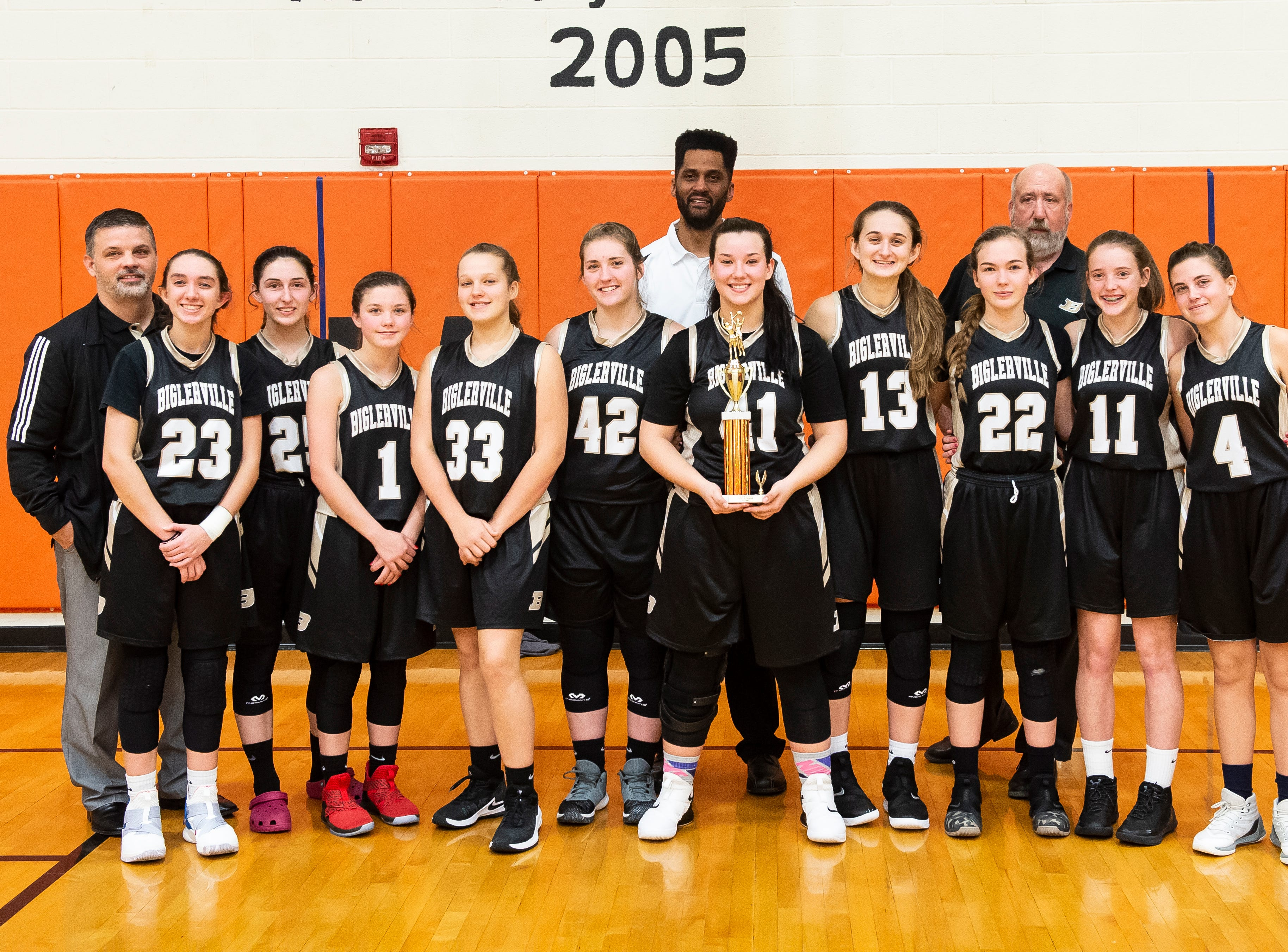 The Biglerville girls' basketball team pose for a team photo after taking second place the Hanover Holiday Classic on Friday, December 28, 2018. Hanover defeated Biglerville 30-20.