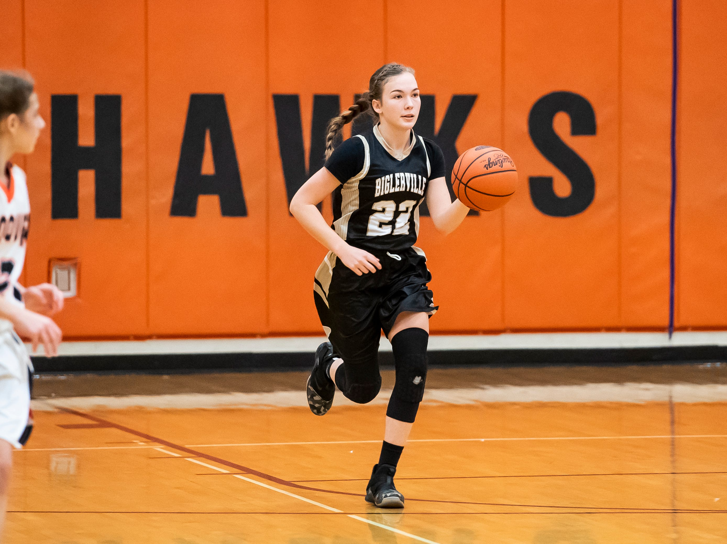 Biglerville's Myla Garber dribbles town the court during play against Hanover in the championship game of the Hanover Holiday Classic on Friday, December 28, 2018. Hanover won 30-20.