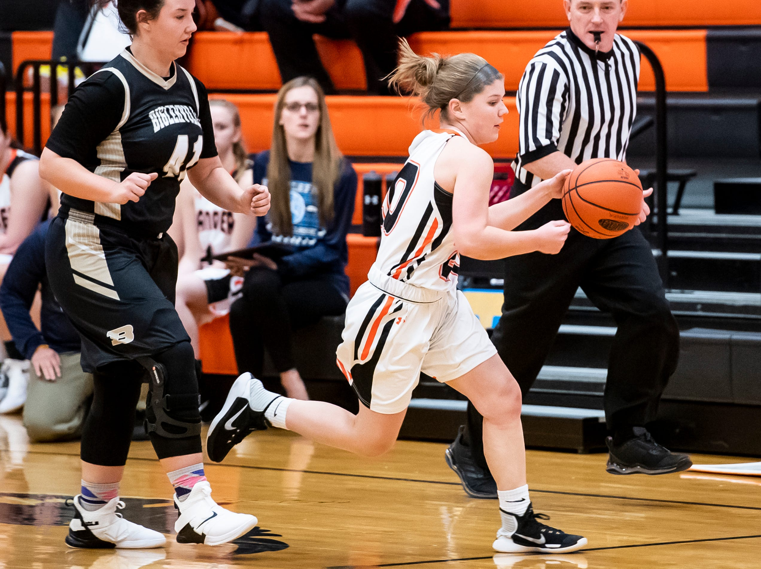 Hanover's Saige Stevens dribbles down the court during play against Biglerville in the championship game of the Hanover Holiday Classic on Friday, December 28, 2018. Hanover won 30-20.