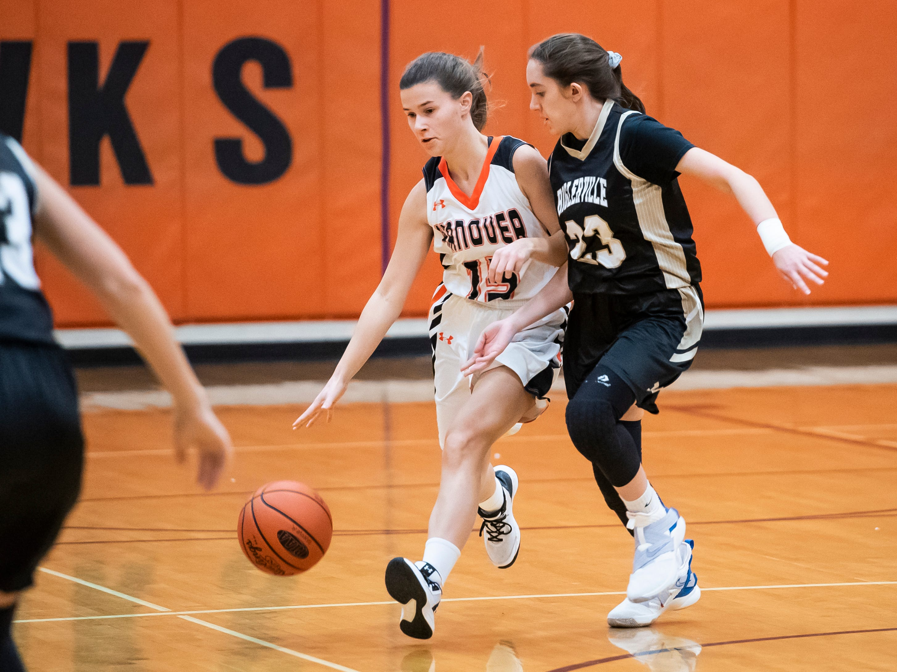Hanover's Madelyn Hutton dribbles the ball down the court alongside Biglerville's Katie Woolson in the championship game of the Hanover Holiday Classic on Friday, December 28, 2018. Hanover won 30-20.