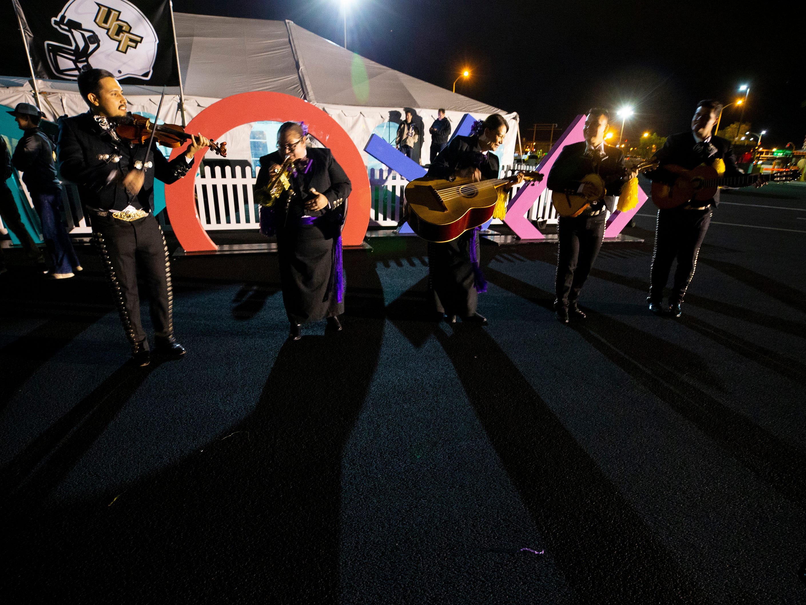 Mariachi Pasion plays while waiting for LSU to arrive at Sky Harbor International Airport in Phoenix on December 27. LSU will face Central Florida in the Fiesta Bowl on New Year's Day