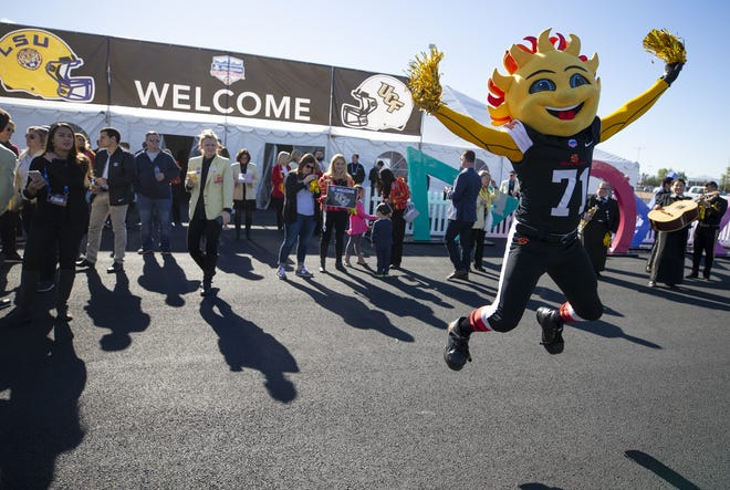 Fiesta Bowl mascot, Spirit, prepares to greet Central Florida football team at Sky Harbor International Airport in Phoenix on Dec. 27, 2018. Central Florida will face LSU in the Fiesta Bowl on New Year's Day.
