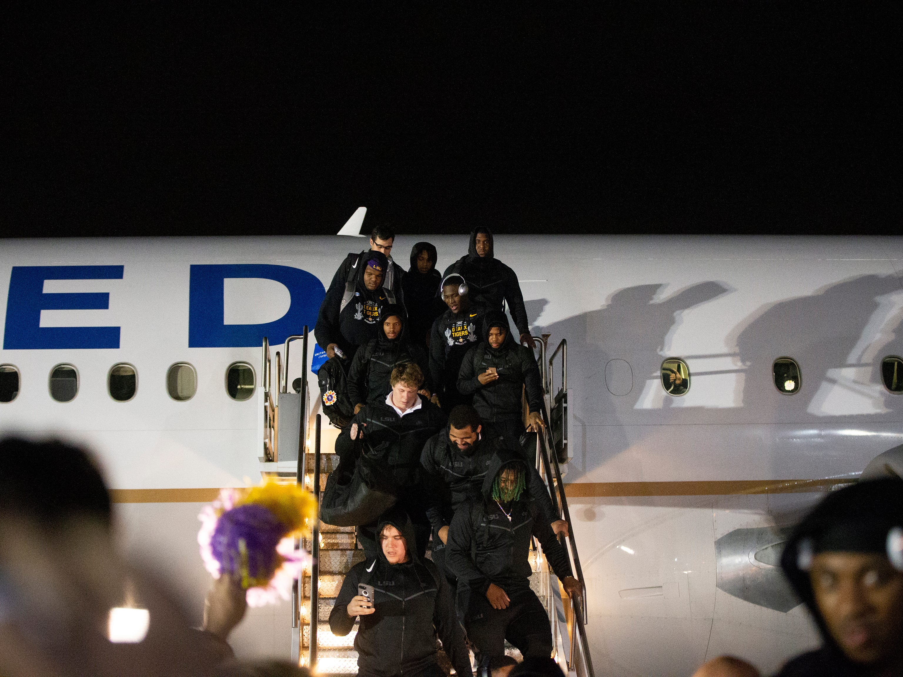 LSU arrives at Sky Harbor International Airport in Phoenix on December 27. LSU will face Central Florida in the Fiesta Bowl on New Year's Day