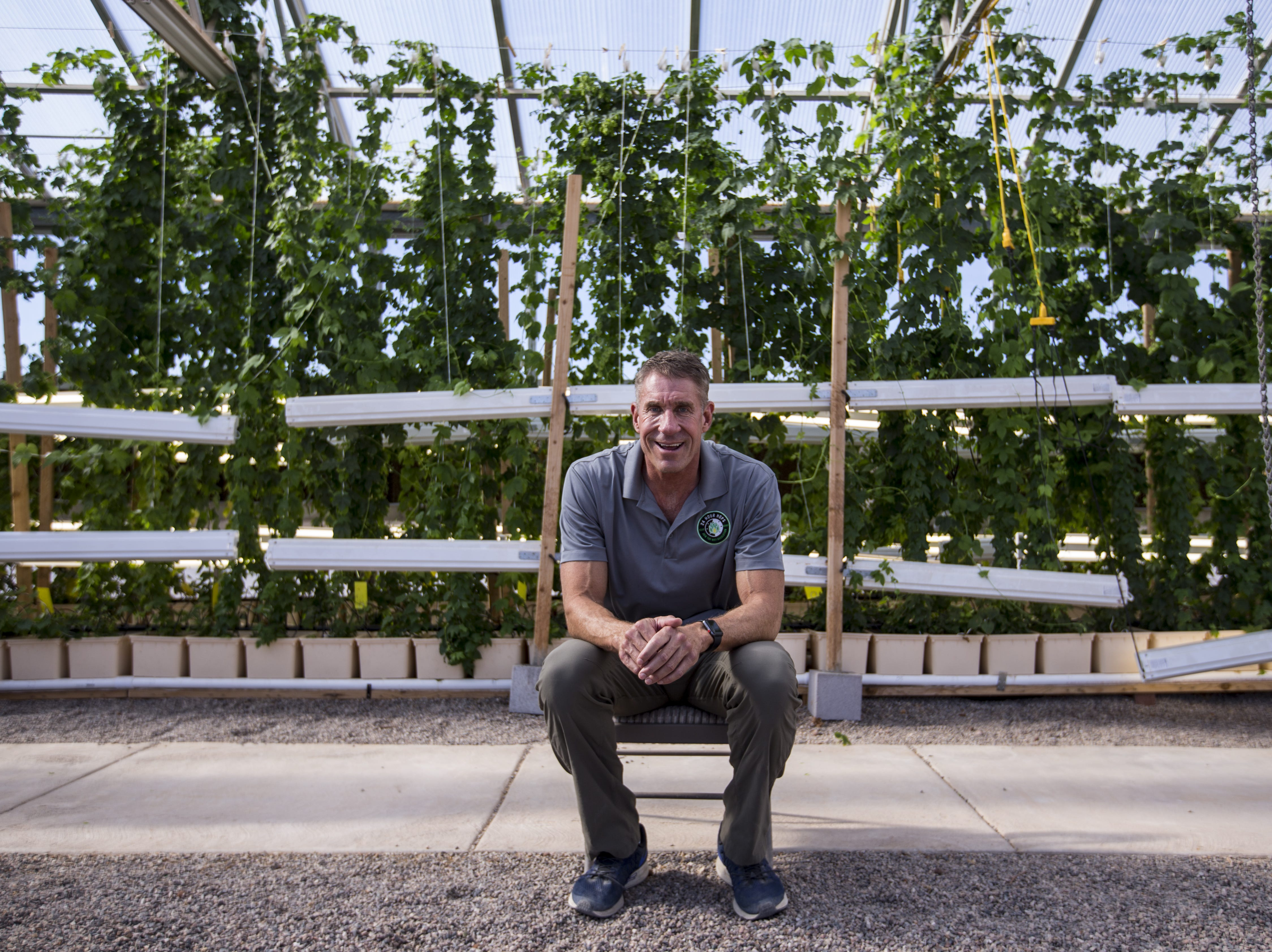 Greg Stelzer in his greenhouse on Dec. 19, 2018, at 24 Hour Hops near Maricopa.