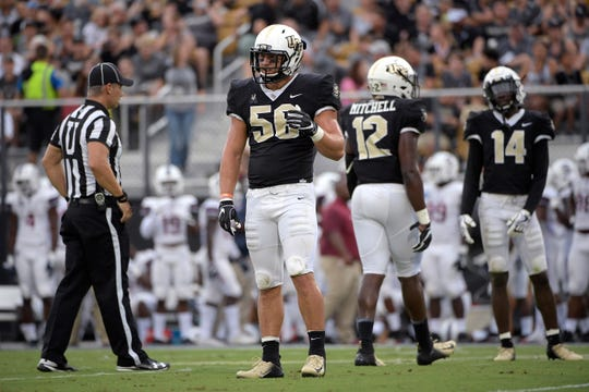 Central Florida linebacker Pat Jasinski (56) sets up for a play during the first half of an NCAA college football game against South Carolina State Saturday, Sept. 8, 2018, in Orlando, Fla. (AP Photo/Phelan M. Ebenhack)