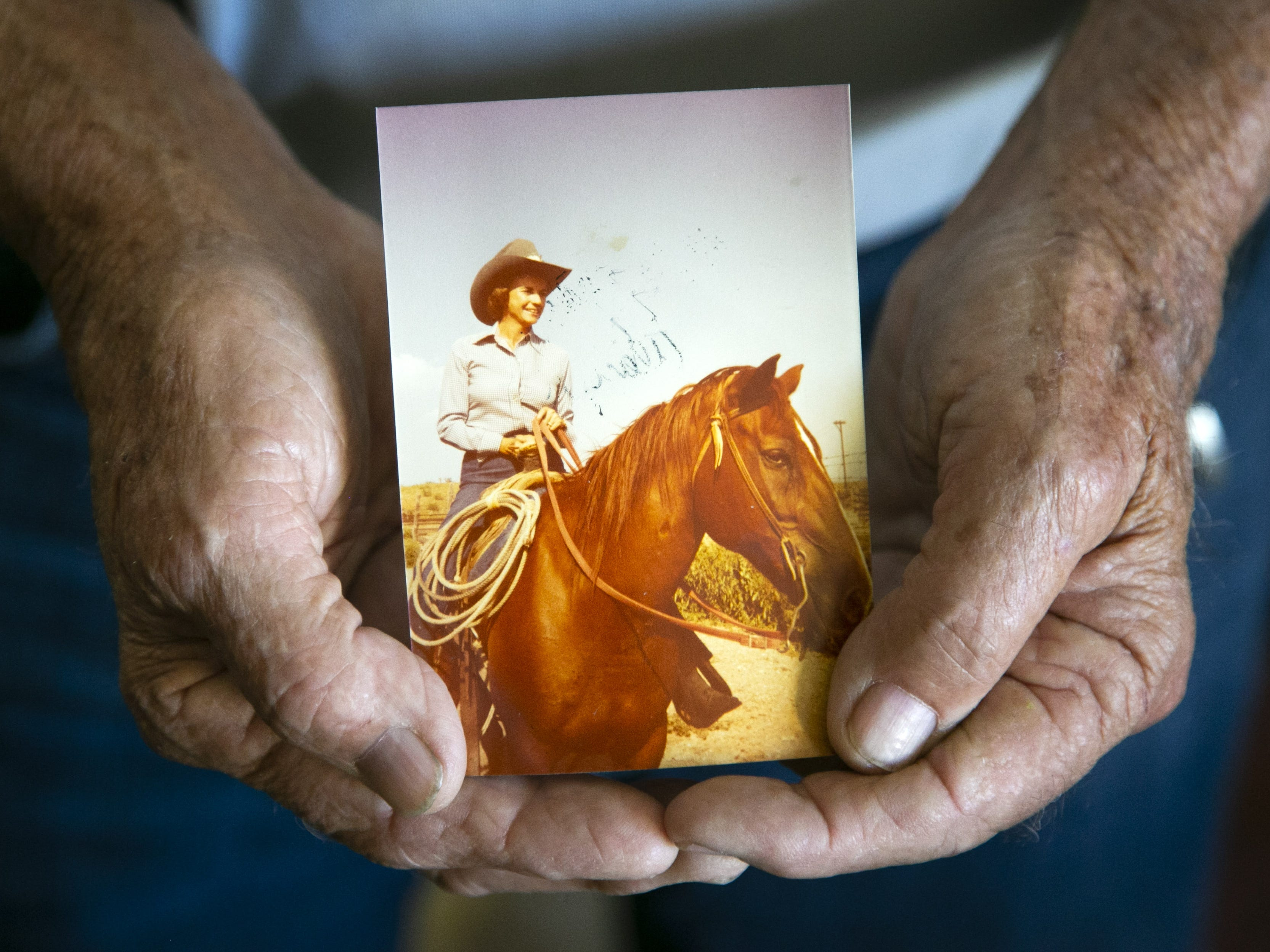 """Alan Day, the brother of former Supreme Court Justice Sandra Day O'Connor, holds a photo his sister riding her favorite horse, """"Chico,"""" at the Lazy B Ranch outside of Duncan, Ariz., in the 1950s. Day was holding the photo at his Oro Valley home on Nov. 1, 2018. Former Supreme Court Justice Sandra Day O'Connor grew up on the cattle ranch."""
