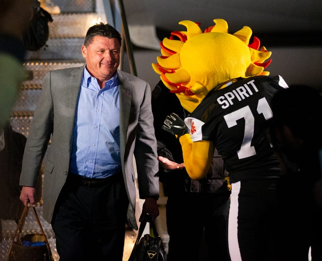 LSU head football coach Ed Orgeron is greeted by Spirit, the Fiesta Bowl mascot, after arriving at Sky Harbor International Airport in Phoenix on December 27. LSU will face Central Florida in the Fiesta Bowl on New Year's Day
