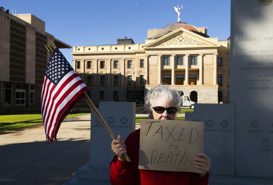 Protesters at Capitol decry $32 car registration fee