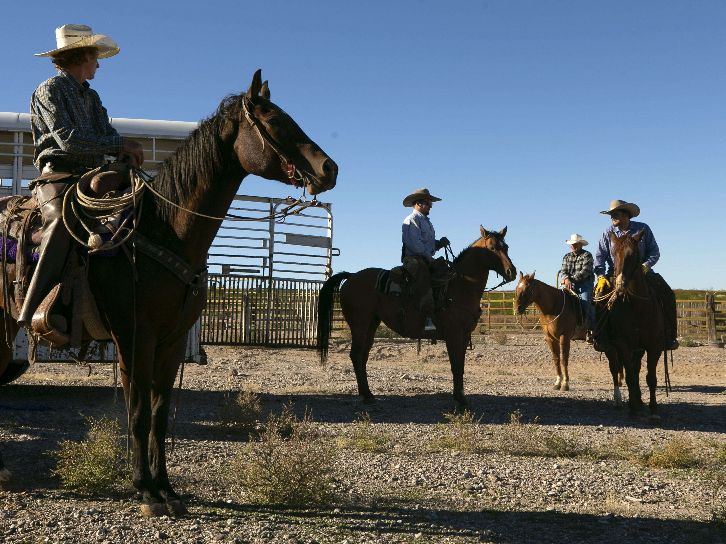 Payson Harsh, 18, (left) and other cowboys before a roundup of cattle at the Lazy B Ranch outside of Duncan, Ariz., on Nov. 2, 2018. Former Supreme Court Justice Sandra Day O'Connor grew up on the ranch.