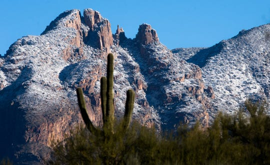 Snow-capped peaks on the western range of the Santa Catalina Mountains with Finger Rock in the background are seen Dec. 28, 2018, in Tucson. A late-December storm brought valley rain and mountain snow to Tucson.