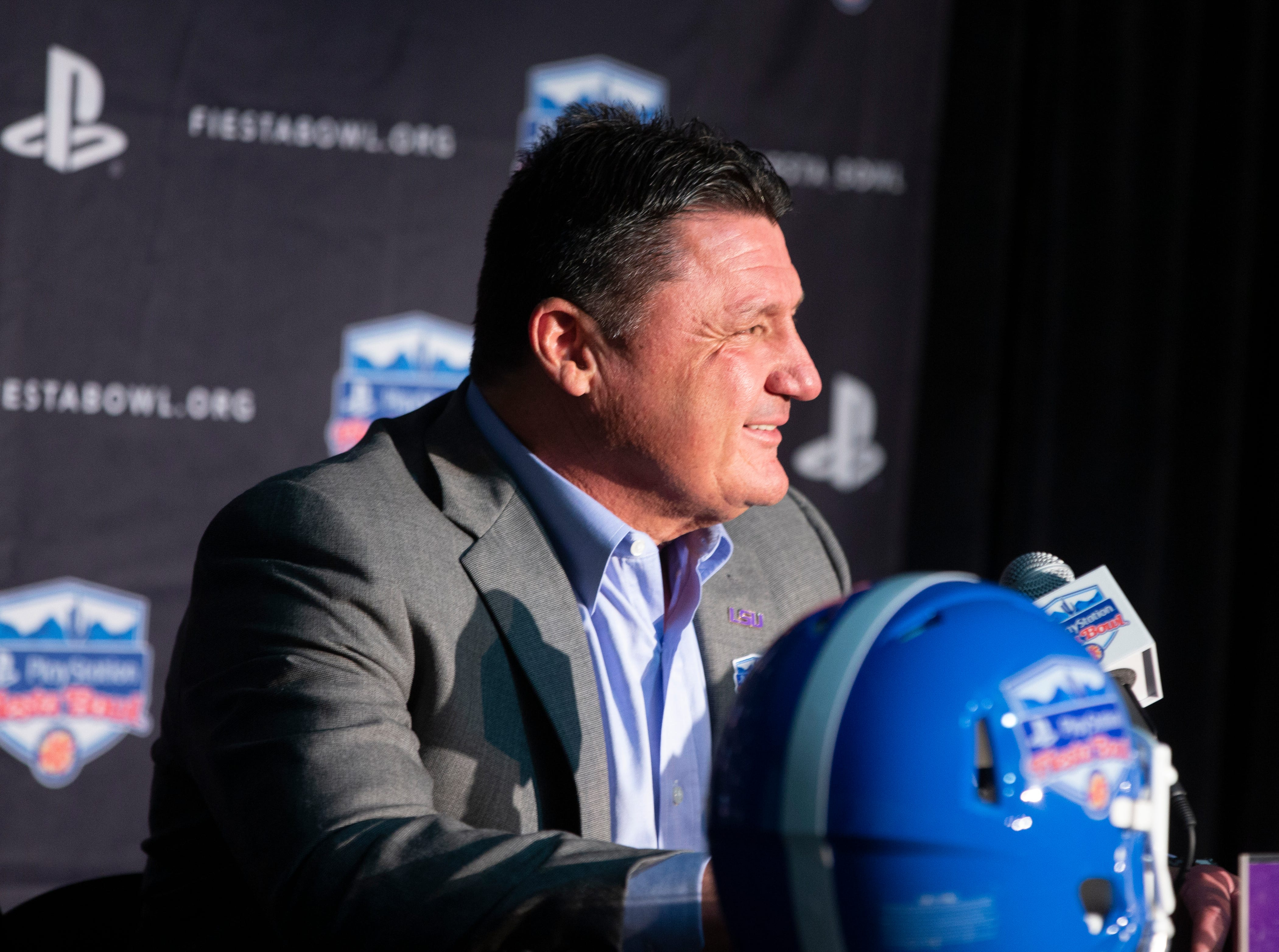 LSU head football coach Ed Orgeron speaks to the media after arriving at Sky Harbor International Airport in Phoenix on December 27. LSU will face Central Florida in the Fiesta Bowl on New Year's Day