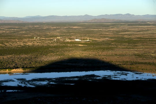 The shadow of Round Mountain casts on the Lazy B Ranch outside of Duncan, Ariz., on Nov. 2, 2018. Former Supreme Court Justice Sandra Day O'Connor grew up on the ranch. Ashes of Harry Alfred Day and Ada Mae Wilkey Day, the parents of Sandra Day O'Connor, were spread atop of Round Mountain. Sandra Day O'Connor has expressed that her ashes are also spread atop the mountain when she dies, according to her brother, Alan Day.