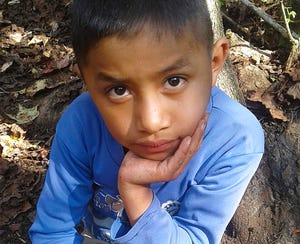 This photo provided by Catarina Gomez on Thursday, Dec. 27, 2018, shows her stepbrother Felipe Gomez Alonzo, 8, near her home in Yalambojoch, Guatemala.
