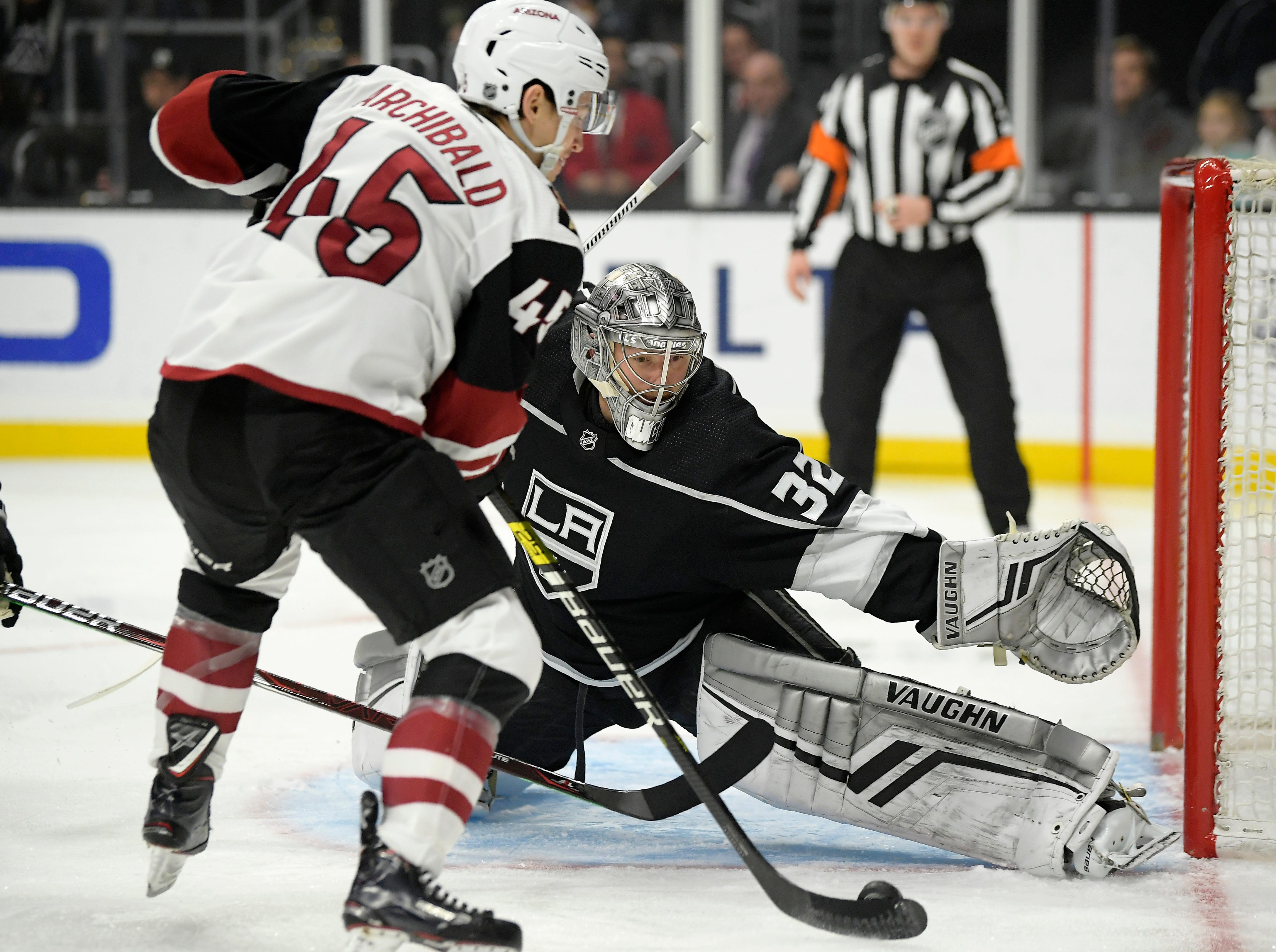 Arizona Coyotes right wing Josh Archibald, left, tries to score on Los Angeles Kings goaltender Jonathan Quick during the first period of an NHL hockey game Thursday, Dec. 27, 2018, in Los Angeles. (AP Photo/Mark J. Terrill)