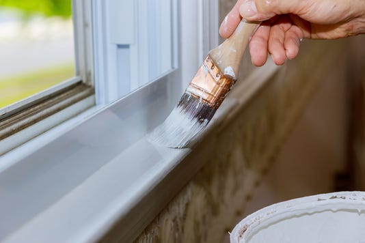 Close Up Of Man Hand Carefully Painting The Edge Of An House Window