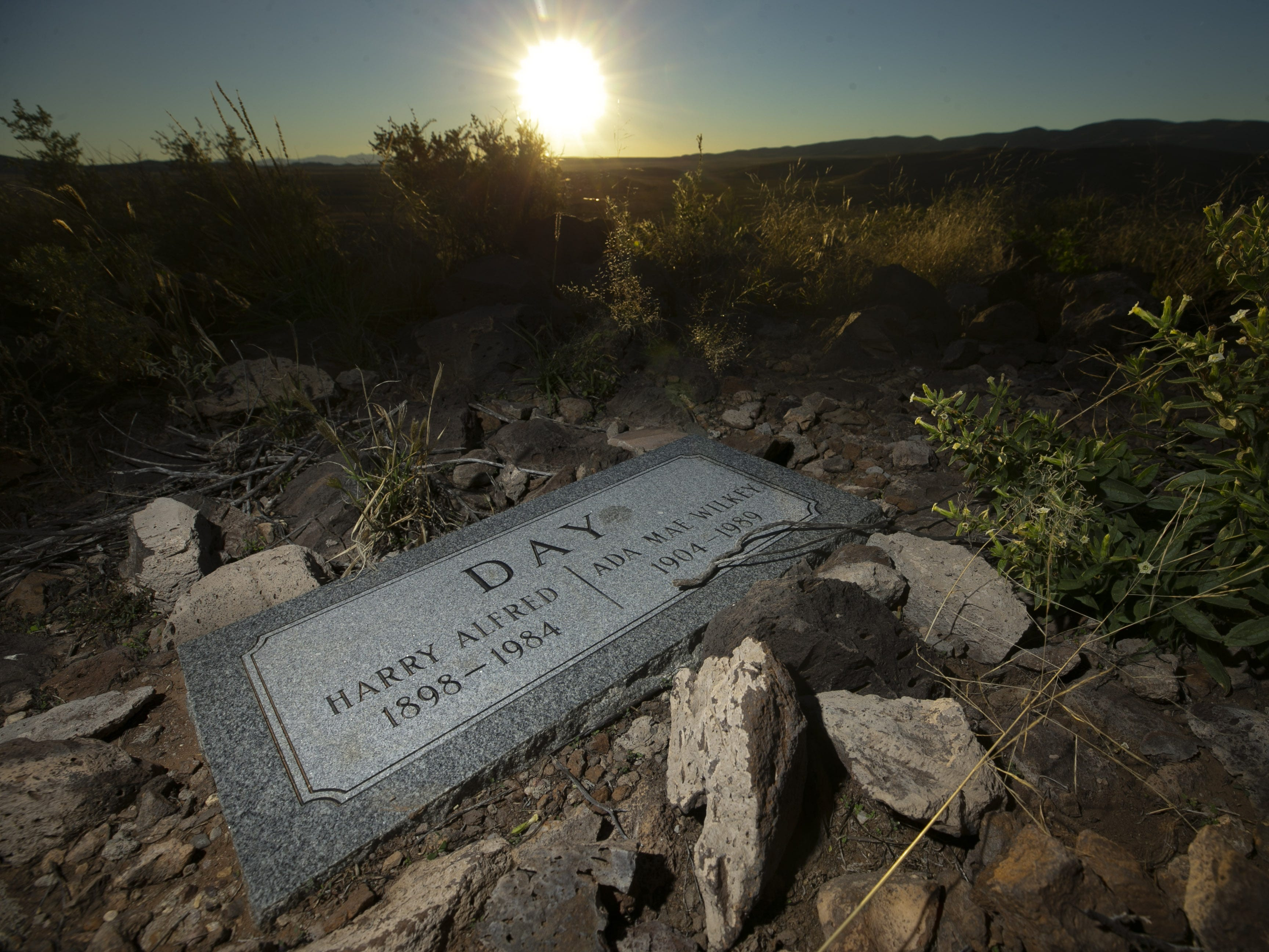 A headstone for Harry Alfred Day and Ada Mae Wilkey Day, the parents of Sandra Day O'Connor atop of Round Mountain on the Lazy B Ranch outside of Duncan, Ariz., on Nov. 2, 2018. Former Supreme Court Justice Sandra Day O'Connor grew up on the ranch. Ashes of Harry Alfred Day and Ada Mae Wilkey Day, were spread atop of Round Mountain. Sandra Day O'Connor has expressed that her ashes are also spread atop the mountain when she dies, according to her brother, Alan Day.