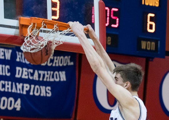 Dylan Anderson of Perry High School dunks against Millennium High School during The Visit Mesa Basketball Challenge is the first tournament ever to use the 35-second shot clock in Arizona high school history.