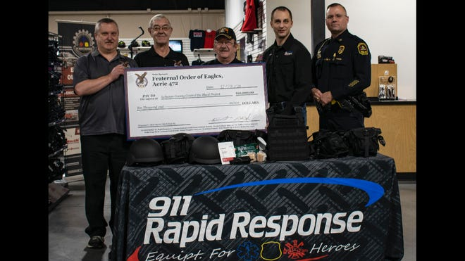 From left to right, Todd Yingst, Bob Fidler, and Jeff Keller of the Fraternal Order of Eagles deliver a $10,000 check to 911 Rapid Response Owner Mark Sallada and North Annville Township Police Chief Matthew Bartal for officer safety equipment.