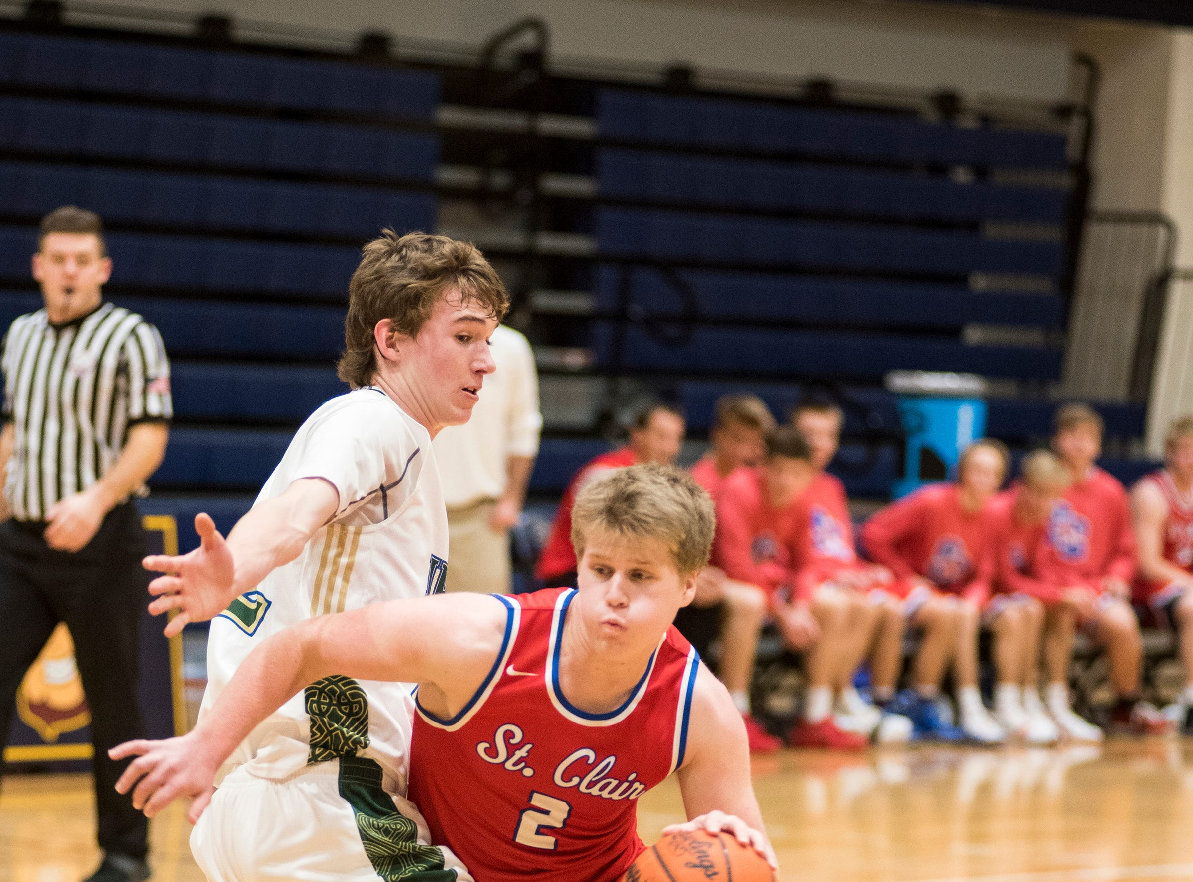 Sarnia St. Patrick's Catholic High School forward Spencer Baillie (left) defends against St. Clair High SChool guard Garrison Dombrowski during their SC4 Holiday Basketball Showcase game Friday, Dec. 28, 2018 at the SC4 Fieldhouse.