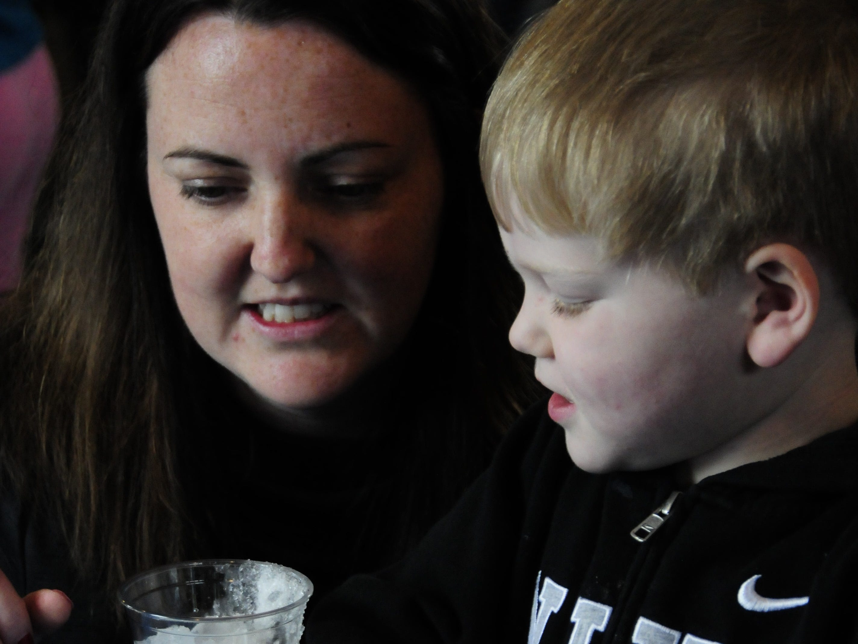 Crystal Ball, of Yale, helps her son, Derek, with an experiment using ice at the Wacky Winter Science event at Fort Gratiot Light Station County Park.