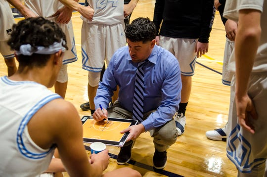 Richmond High School head coach Josh Presnell works with the team in a time out during their SC4 Holiday Basketball Showcase game against Sandusky High School  Friday, Dec. 28, 2018 at the SC4 Fieldhouse.