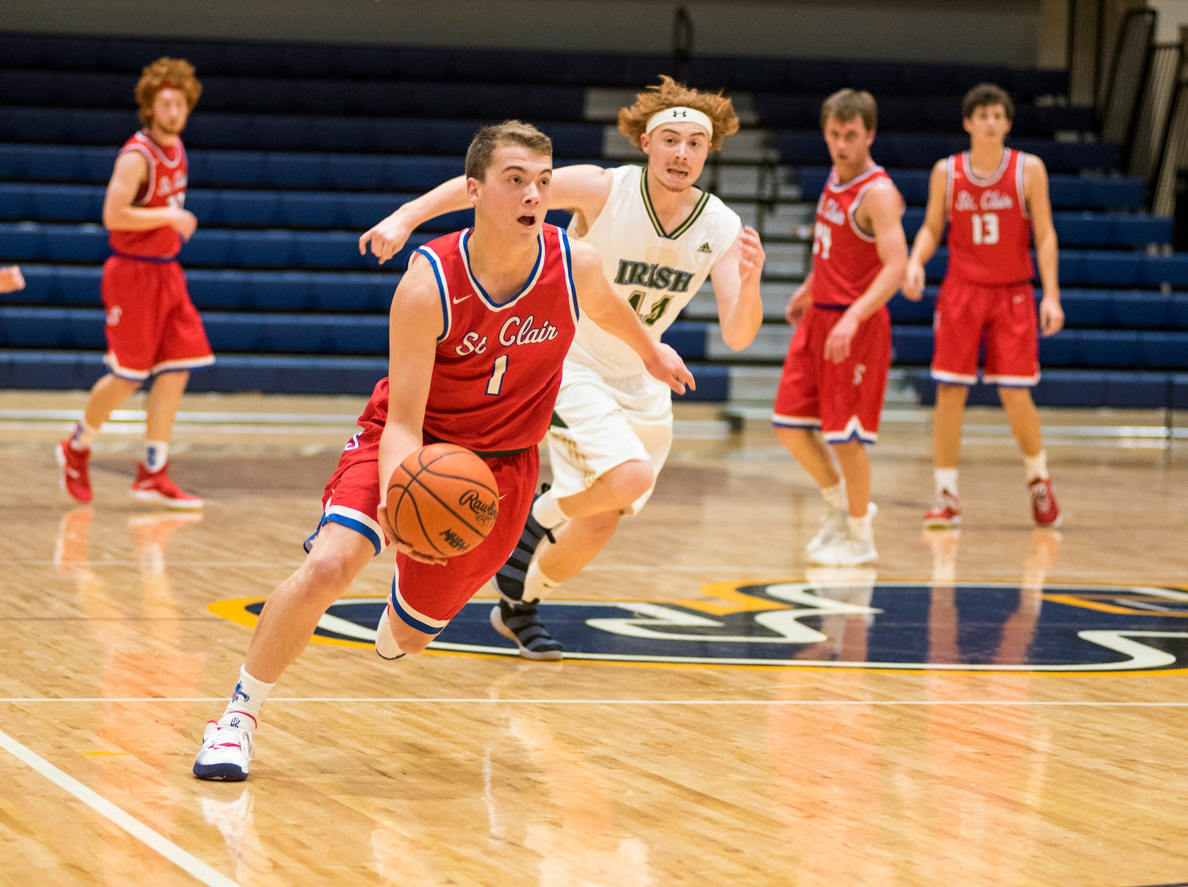 St. Clair High School guard Austin Schweiger dribbles the ball down the court during their SC4 Holiday Basketball Showcase game against Sarnia St. Patrick's Catholic High School  Friday, Dec. 28, 2018 at the SC4 Fieldhouse.