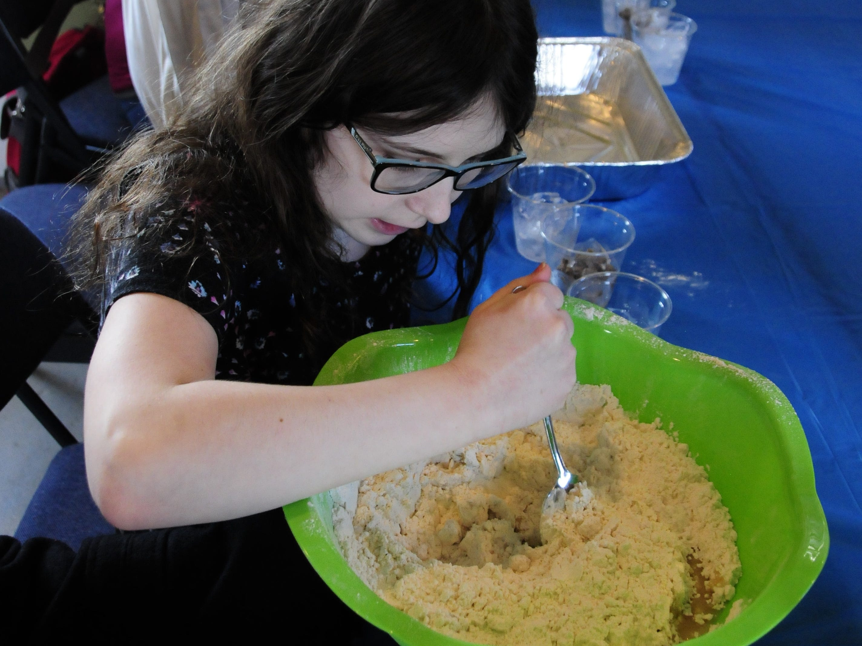 Ella Kraus mixes a batch of snow sand at the Wacky Winter Science event at Fort Gratiot Light Station County Park.