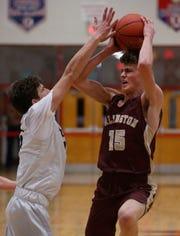 Beacon's Shane Green blocks Arlington's Jack Weinstein during the Duane Davis Basketball Tournament on Friday at Roy C. Ketcham High School on December 27, 2018.