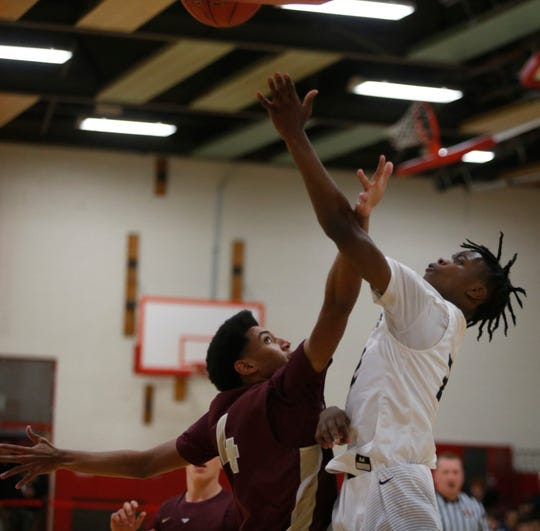 Arlington's Delano Knox attempts to block a shot from Beacon's Dayton Thompson during the Duane Davis Basketball Tournament on Friday at Roy C. Ketcham High School on December 27, 2018.